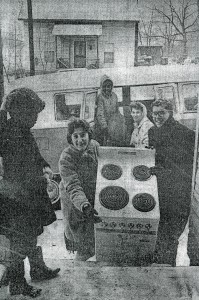 Beth Pirkle and Mike Bridges move a stove into their new home on Patterson Avenue in 1966.