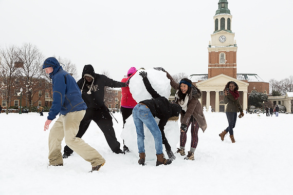 Wake Forest students play in the snow on Hearn Plaza during a major storm on Thursday, February 13, 2014.