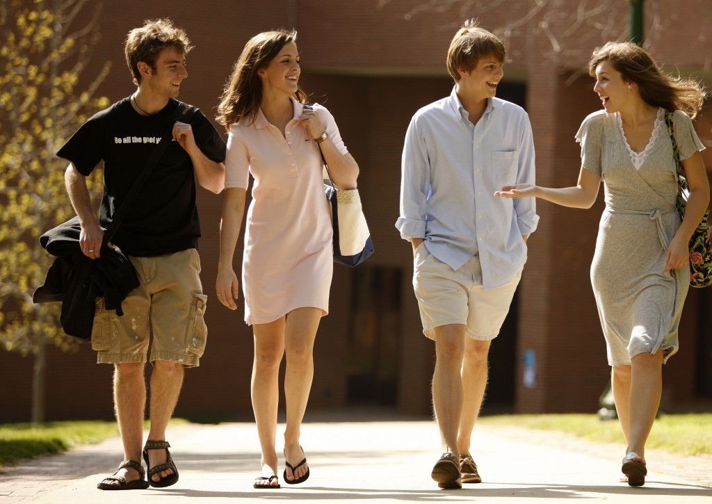 Mark Hoover (far left) with Melissa Beckett ('10), Robert Cox ('10)  and Sarah Nick ('10) on campus in 2008.