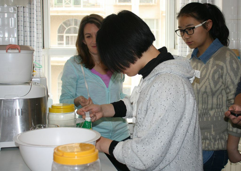 Allison teaches the science of baking to Chinese girls.