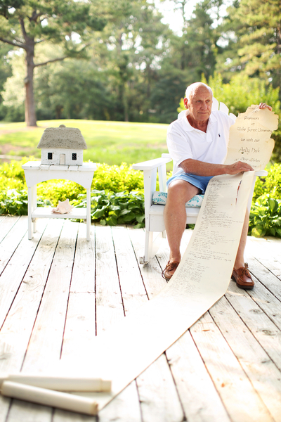 The scroll is so long that Heck unrolls it on the deck at his rebuilt home in Pawleys Island, South Carolina.