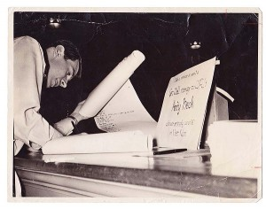 A student signs the get-well scroll.