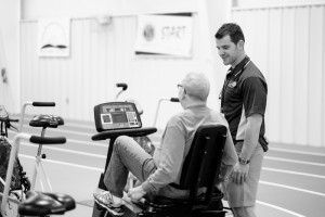 Photos from the Wake Forest HELPS program, at the Health and Exercise Science clinical research facility, on Monday, March 16, 2015. HES graduate student Seth Christopher talks with a participant.