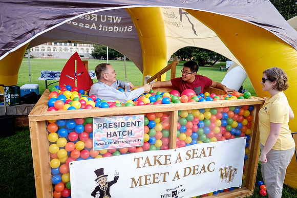 Wake Forest hosts move-in day for first year students at the south campus residence halls on Friday, August 21, 2015. President Nathan O. Hatch talks with a student in the ball pit on the lower quad.