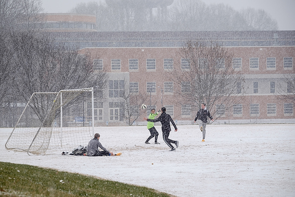 Wake Forest students play soccer on Poteat Field during a snowstorm on Wednesday, January 20, 2016.