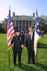Port Authority police officer S. Keane and WFU University Stores director Buz Moser.