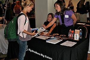 Students talking to the Big Brothers Big Sisters representatives