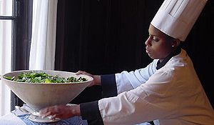 A student works as a buffet attendant.