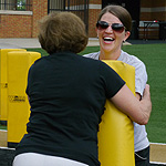 McCormick tackles Katie Neal ('03) of Communications & External Relations