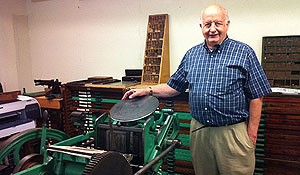 Craig Fansler with printing equipment