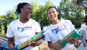 Lena Nelson ('15) and Amber Burton ('15) help build a Habitat for Humanity house as part of the SPARC pre-orientation volunteer service group.