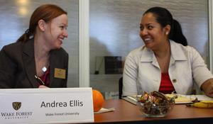 Andrea Ellis, left, talks with a colleague.