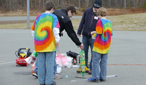 Wake Forest senior Sean Cusano ('13) and first-year Wake medical student Matthew Martin (BS '12) examine a team's bottle rocket.