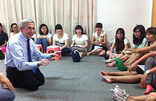 Sam Gladding with students in China