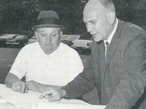 """Pete Moore (at right) with assistant Melvin """"Molly"""" Layton ('47)."""